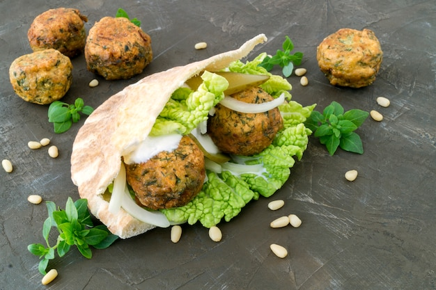 Falafel. the meatballs from chickpea in pita. Premium Photo
