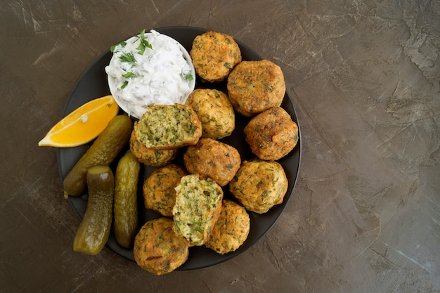 Falafel, a traditional israeli dish of chickpea. Premium Photo