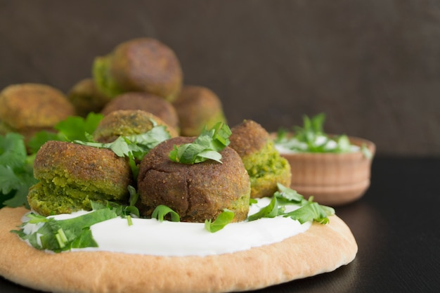 Falafel, a traditional israeli dish of chickpea. Premium Photo