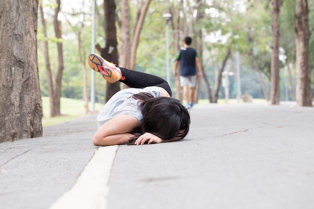 Fall of a woman while running in park Premium Photo