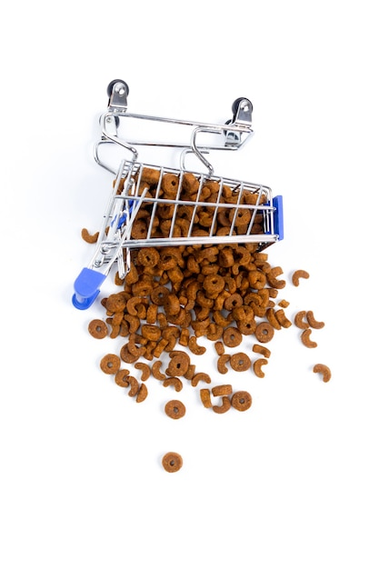 Fallen shopping cart with food for animals, dogs, cats. isolate, top view Premium Photo