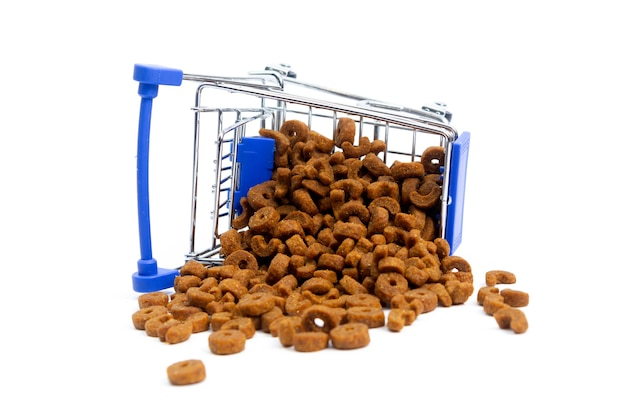 Fallen shopping cart with food for animals, dogs, cats. isolate Premium Photo