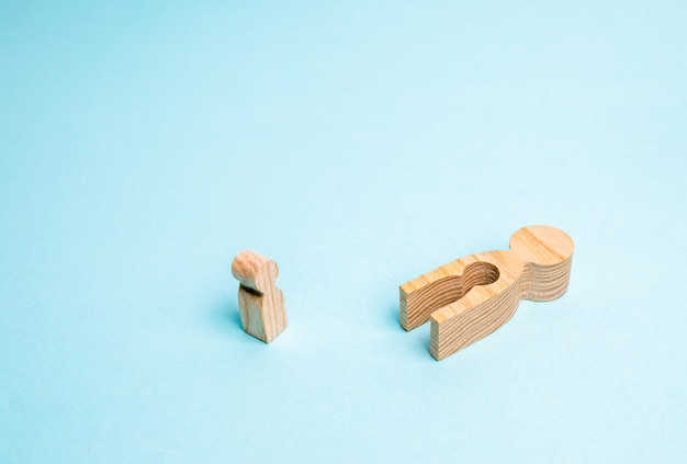 A fallen wooden man with a void in the body from which the child fell. Premium Photo