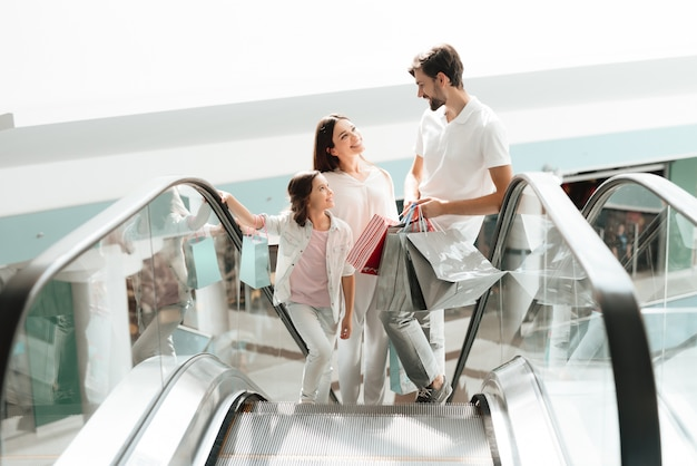 Family are going up on escalator in shopping mall. Premium Photo