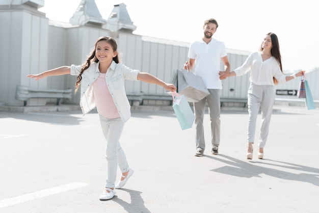 Family are walking on parking after shopping in mall Premium Photo