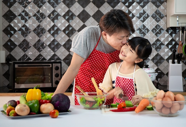 Family asian cooking in the kitchen Premium Photo