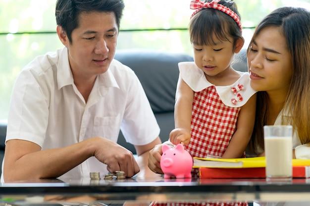 Premium Photo   Family asian saving money in piggy bank . save money