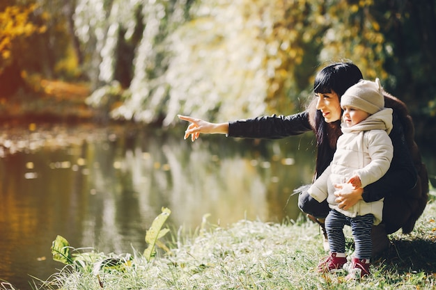 Family in a autumn park Free Photo