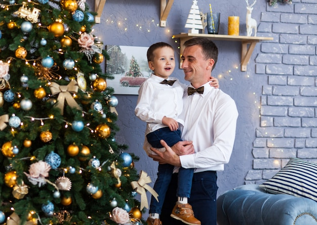 Family beside a christmas tree at home Premium Photo