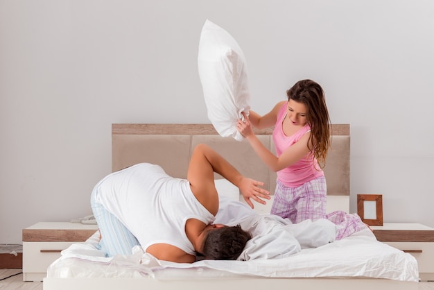 Family conflict with wife husband in bed Premium Photo