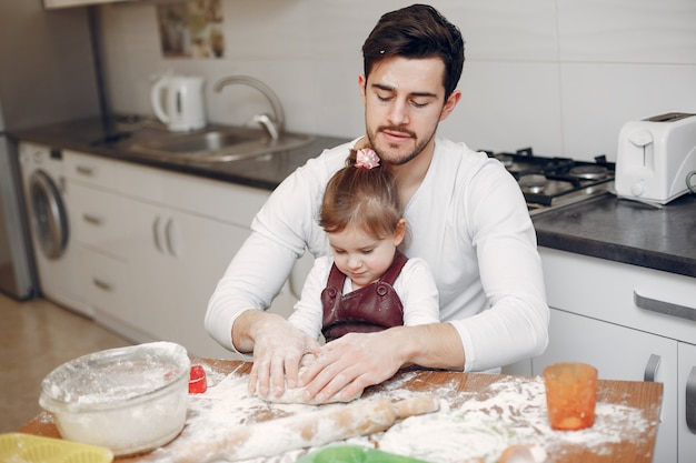 Family cook the dough for cookies Free Photo
