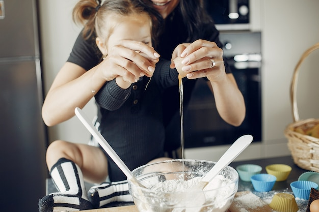 Family cooks the dough for cookies Free Photo