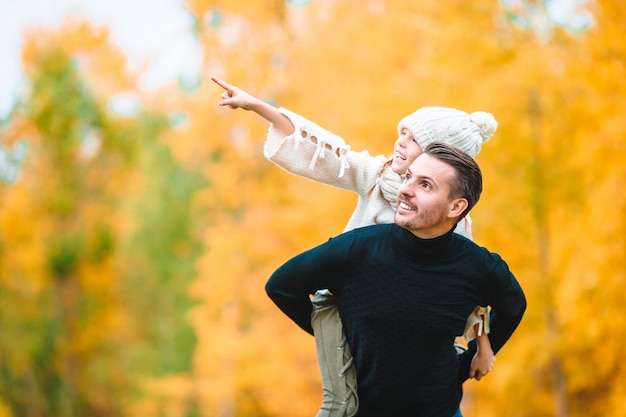 Family of dad and kid on beautiful autumn day in the park Premium Photo