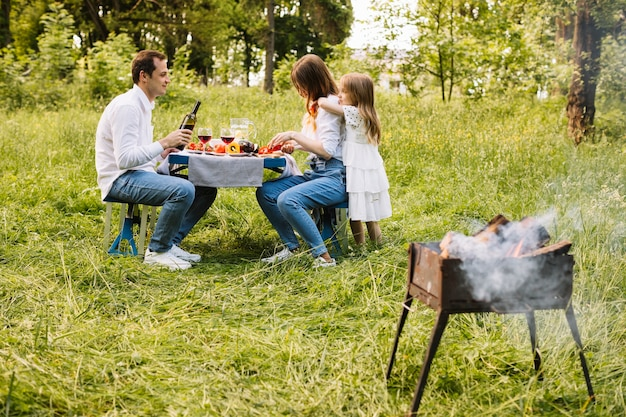 Family doing a barbecue in nature Free Photo