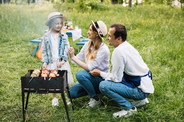 Family doing a barbecue in nature Premium Photo