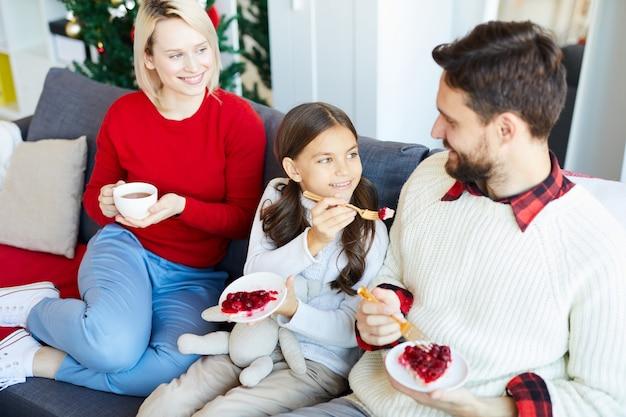 Family eating homemade dessert Free Photo