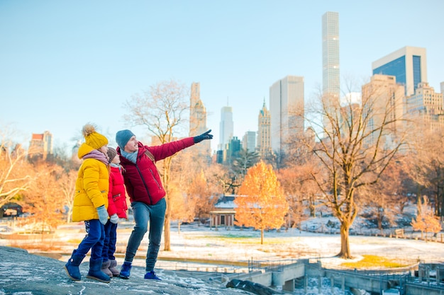 Family of father and kids in central park during their vacation in new york city Premium Photo
