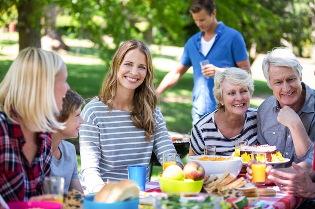 Family and friends having a picnic with barbecue Premium Photo