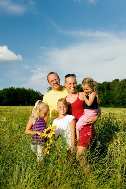 Family in a grass field Premium Photo