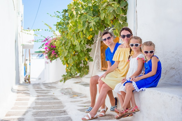 Family having fun outdoors on mykonos streets Premium Photo