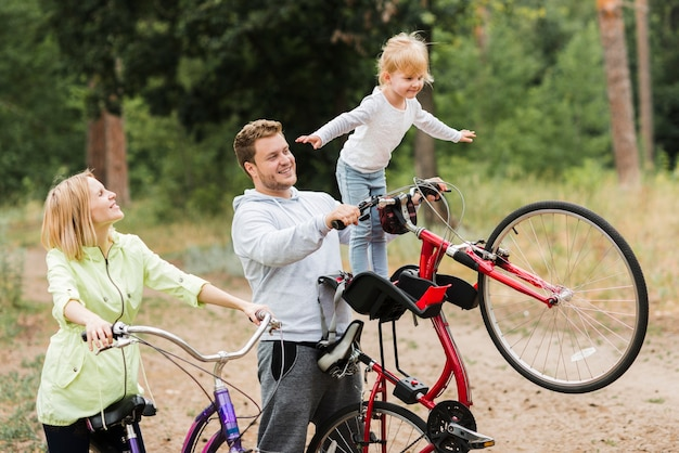 Family having a great time outdoors with bicycles Free Photo