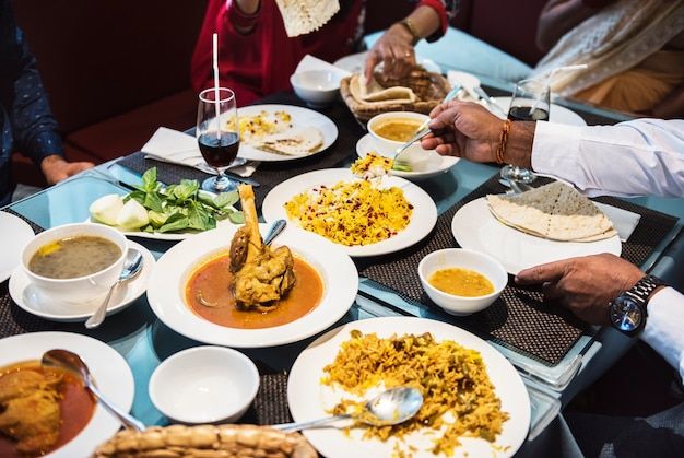 Family Having Indian Food Photo Free Download