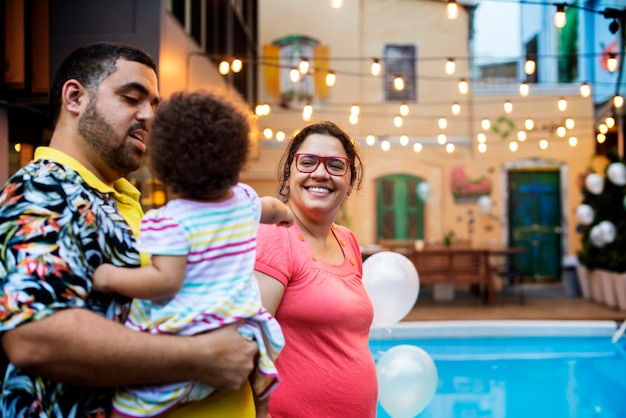 Family having a kid's birthday party Free Photo