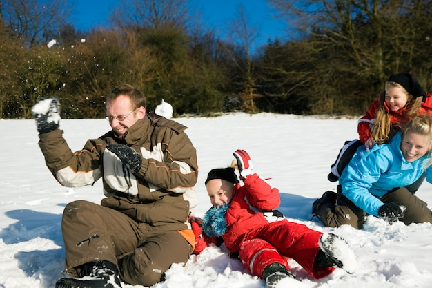 Family having a snowball fight Premium Photo