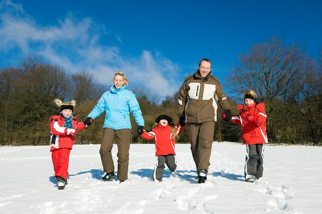 Family having a walk in the snow Premium Photo