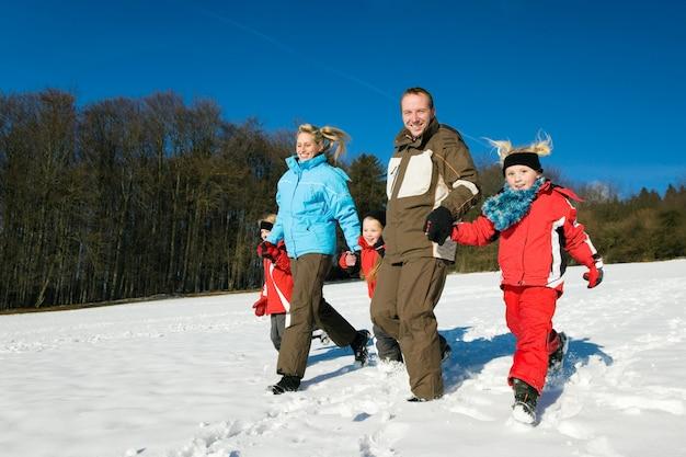 Family having a walk in the snow Premium Photo