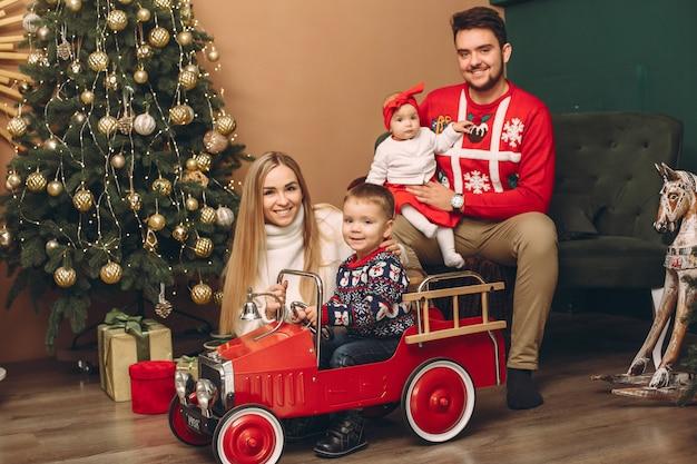 Family at home near christmas tree Free Photo