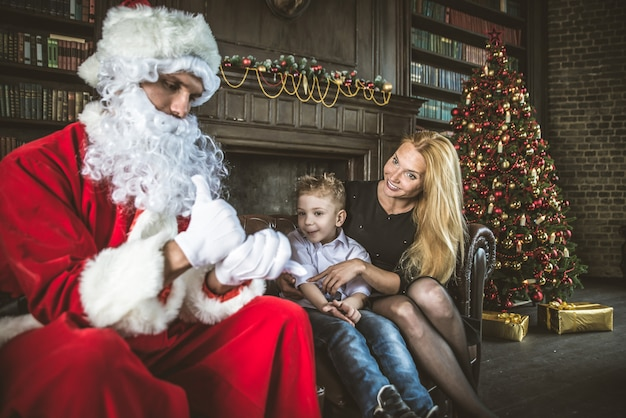 Family home portrait. parents and son spending time together at christmas time Premium Photo