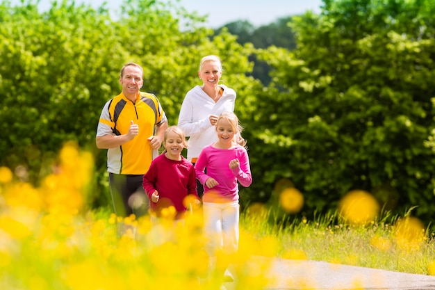 Family jogging for sport outdoors Premium Photo