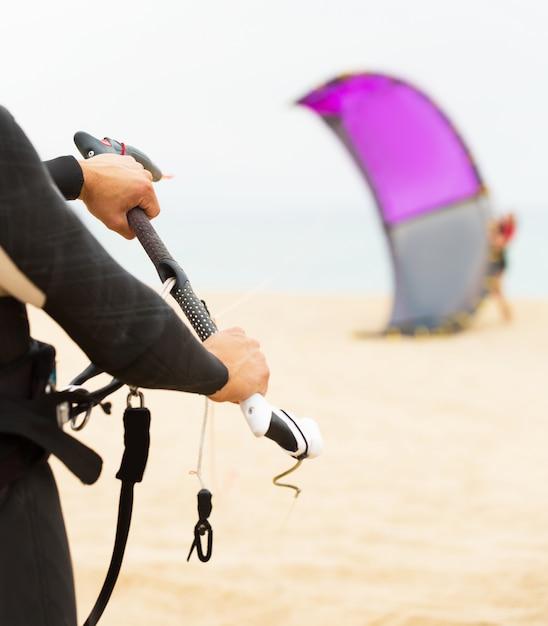 Family of kitesurfers at the ocean beach Premium Photo