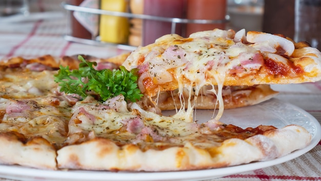 Family lunch eating pizza ham cheese recipe Free Photo