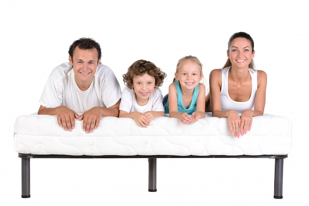 Family lying on mattresses, isolated Premium Photo
