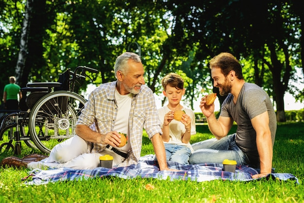 Family meeting in park relatives have picnic Premium Photo