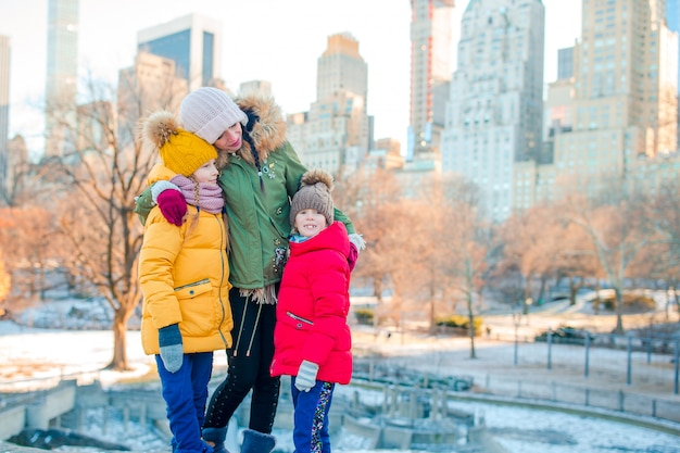 Family of mother and kids in central park during their vacation in new york city Premium Photo