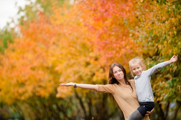 Family of mother and little kid outdoors in park at autumn day Premium Photo
