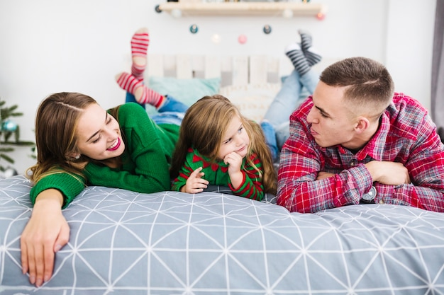 Family on bed at christmas Free Photo