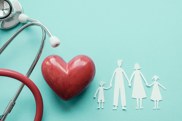 Family paper cut out with red heart and stethoscope, heart health, family health insurance concept Premium Photo
