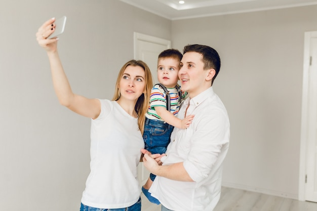 Family picture of two young parents playing with their boy child Free Photo