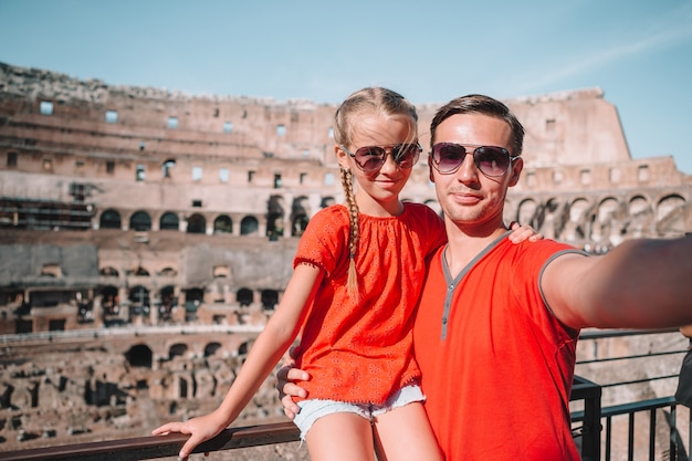 Family portrait at famous places in europe Premium Photo