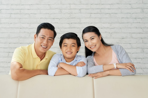 Family portrait at modern living room Free Photo