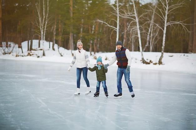 Family portrait on skating rink Free Photo