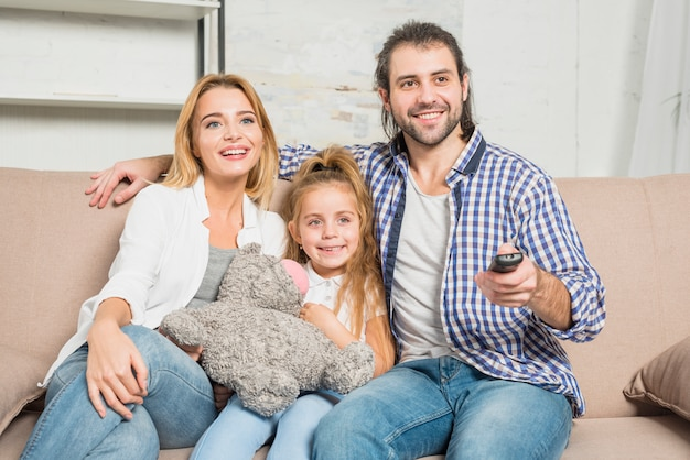Family portrait on the sofa with teddy bear Free Photo