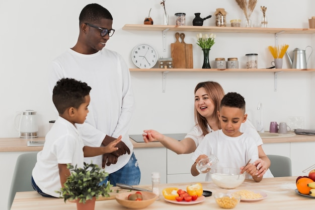 Family preparing dinner together Free Photo