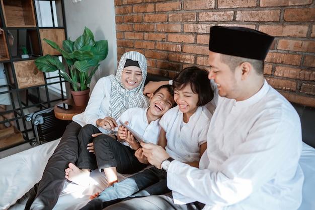 Family on ramadan kareem using tablet Premium Photo