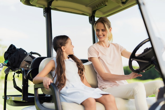 Family relationships golfers play sports together. Premium Photo