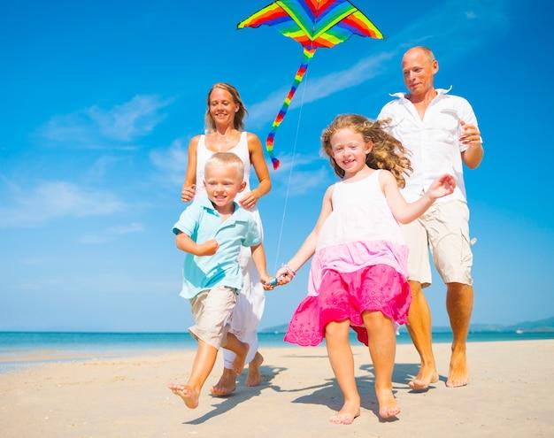 Family running on the beach. Premium Photo